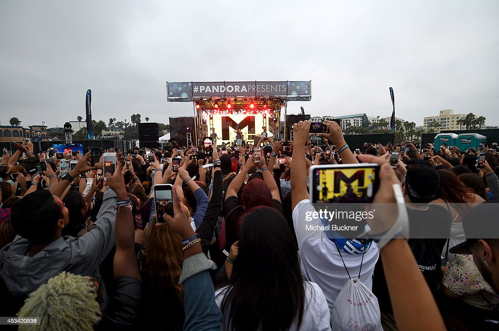 The band 'Magic!' performs at Pandora Presents on the Santa Monica Pier on August 9, 2014 in Santa Monica, California.