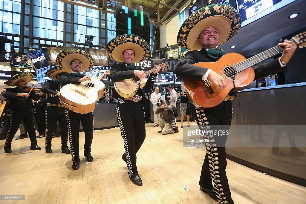 The band Mariachi Real de Mexico performs on the floor of the New York Stock Exchange ahead of the Cinco de Mayo holiday after the closing bell on May 3, 2013 in New York City. The Dow Jones Industrial Average briefly eclipsed 15,000 before settling at 14,973.96, a record high, following positive jobs numbers.