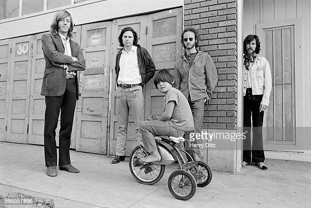 The band members of The Doors from left to right Ray Manzarek Jim Morrison Robbie Krieger and John Densmore