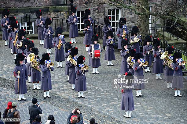 The Band of The Royal Regiment of Scotland play before Gunners from 105th Regiment Royal Artillery fire a 21Gun Royal Salute at Edinburgh Castle on...