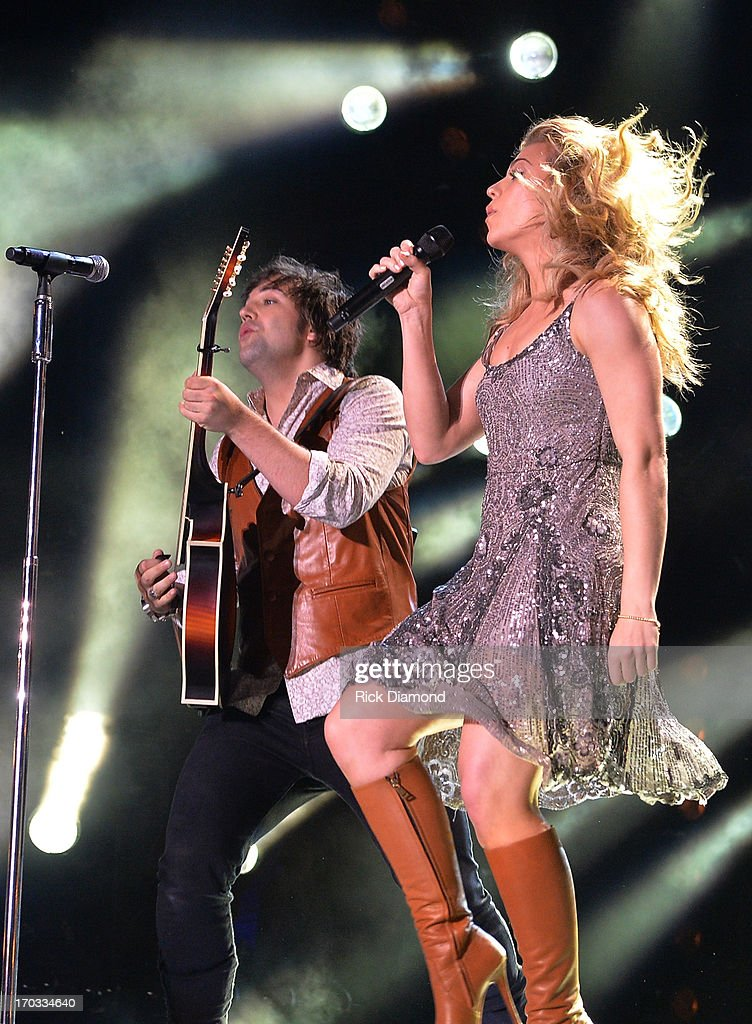The Band Perry, Neil Perry and Kimberly Perry perform during the 2013 CMA Music Festival on June 9, 2013 in Nashville, Tennessee.