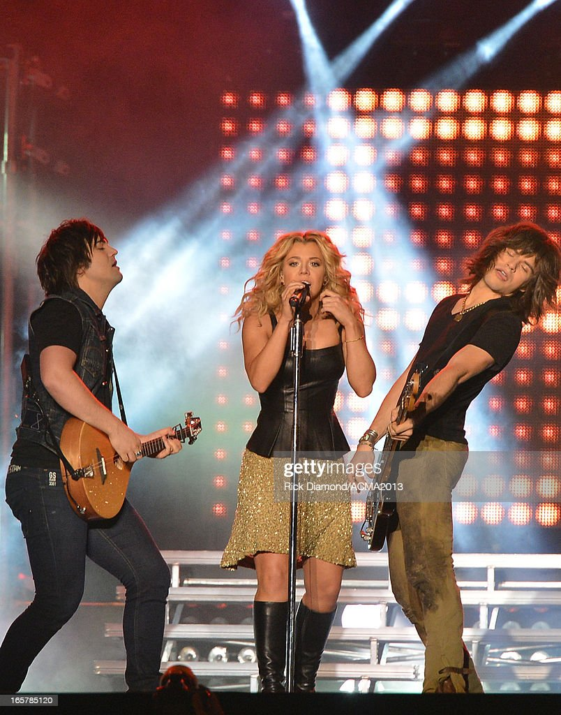 The Band Perry Neil Perry, <a gi-track='captionPersonalityLinkClicked' href=/galleries/search?phrase=Kimberly+Perry&family=editorial&specificpeople=6718325 ng-click='$event.stopPropagation()'>Kimberly Perry</a> and <a gi-track='captionPersonalityLinkClicked' href=/galleries/search?phrase=Reid+Perry&family=editorial&specificpeople=6718326 ng-click='$event.stopPropagation()'>Reid Perry</a> perform at the ACM Party For A Cause Festival during the 48th Annual Academy of Country Music Awards at the Orleans Arena on April 5, 2013 in Las Vegas, Nevada.