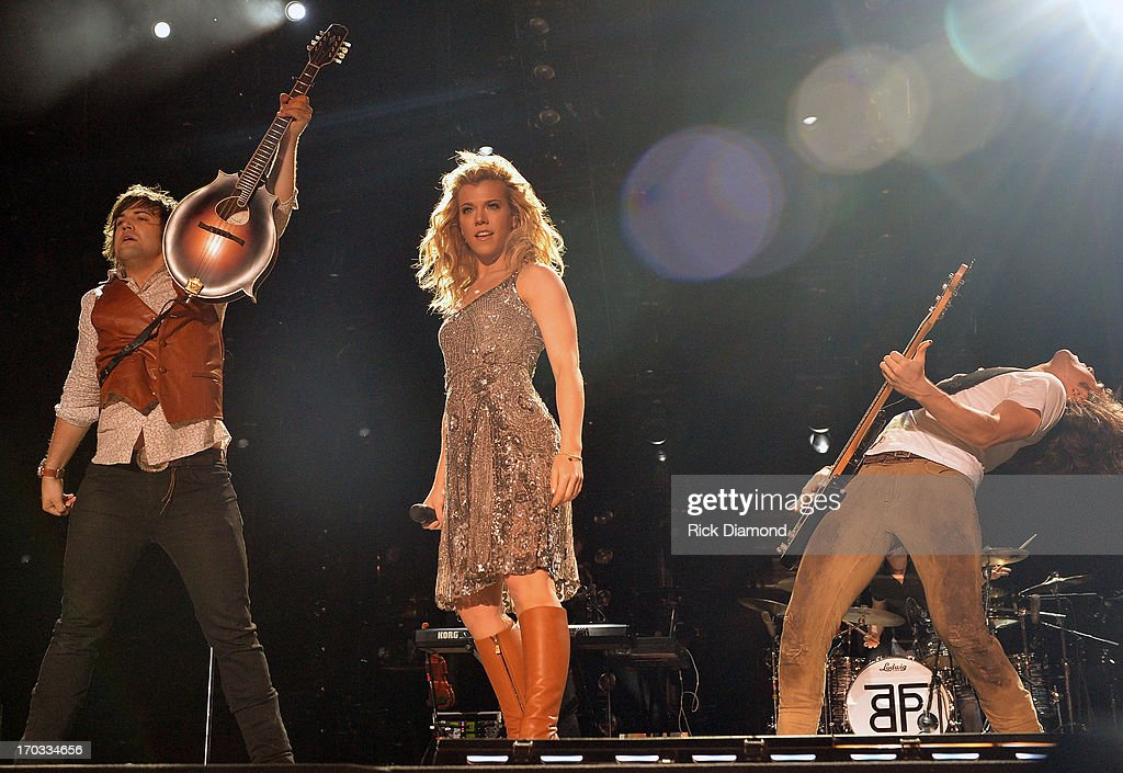 The Band Perry, Neil Perry, Kimberly Perry and Reid Perry perform during the 2013 CMA Music Festival on June 9, 2013 in Nashville, Tennessee.