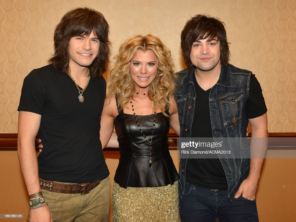 The Band Perry Reid Perry, Kimberly Perry and Neil Perry perform at the ACM Party For A Cause Festival during the 48th Annual Academy of Country Music Awards at the Orleans Arena on April 5, 2013 in Las Vegas, Nevada.