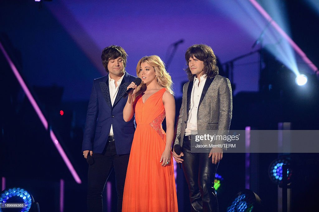 The band Perry speak onstage during the 2013 CMT Music awards at the Bridgestone Arena on June 5, 2013 in Nashville, Tennessee.