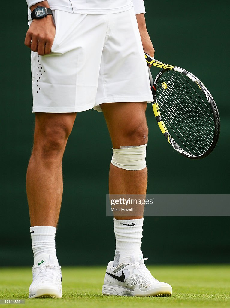 The bandaged knee of Rafael Nadal of Spain during his Gentlemen's Singles first round match against Steve Darcis of Belgium on day one of the Wimbledon Lawn Tennis Championships at the All England Lawn Tennis and Croquet Club on June 24, 2013 in London, England.