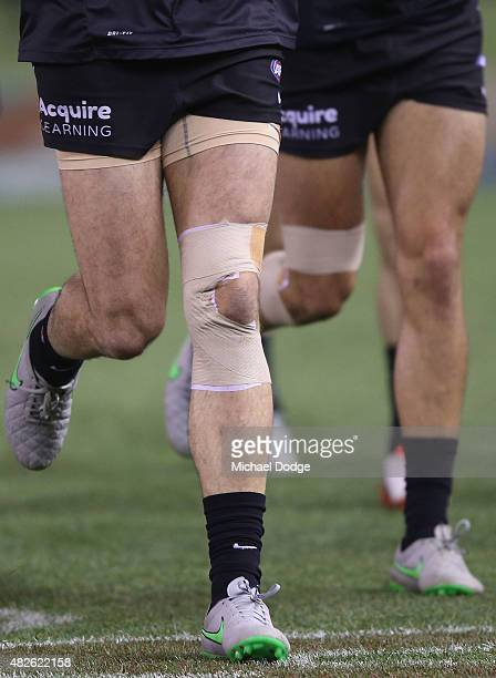 The bandaged up leg of Simon White of the Blues is seen during the round 18 AFL match between the Carlton Blues and the North Melbourne Kangaroos at...