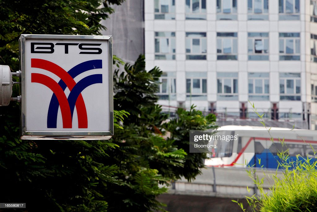 The Bangkok Mass Transit System Pcl logo, a unit of BTS Group Holdings Pcl, is displayed at Chong Nonsi Station as a SkyTrain approaches in central Bangkok, Thailand, on Thursday, April 4, 2013. The BTS Rail Mass Transit Growth Infrastructure Fund, backed by Bangkok's SkyTrain, raised about 62.5 billion baht ($2.1 billion) in Thailand's biggest initial public offering. Photographer: Dario Pignatelli/Bloomberg via Getty Images