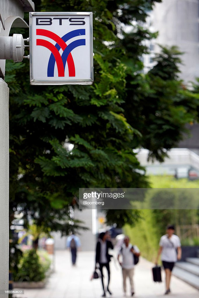 The Bangkok Mass Transit System Pcl logo, a unit of BTS Group Holdings Pcl, is displayed at the SkyTrain Chong Nonsi Station in central Bangkok, Thailand, on Thursday, April 4, 2013. The BTS Rail Mass Transit Growth Infrastructure Fund, backed by Bangkok's SkyTrain, raised about 62.5 billion baht ($2.1 billion) in Thailand's biggest initial public offering. Photographer: Dario Pignatelli/Bloomberg via Getty Images