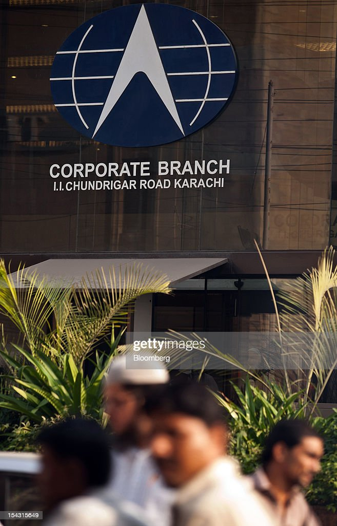 The Bank Alfalah Ltd. logo is displayed at one of the bank's branches in Karachi, Pakistan, on Wednesday, Oct. 17, 2012. Bank Alfalah, Pakistan's second-biggest Islamic lender, may see 20 percent growth in net income this year and in 2013 as it expands its branch network to tap growing demand for Shariah-compliant finance. Photographer: Asim Hafeez/Bloomberg via Getty Images