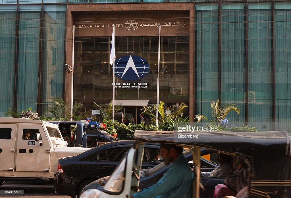 The Bank Alfalah Ltd. logo is displayed outside one of the bank's branches in Karachi, Pakistan, on Wednesday, Oct. 17, 2012. Bank Alfalah, Pakistan's second-biggest Islamic lender, may see 20 percent growth in net income this year and in 2013 as it expands its branch network to tap growing demand for Shariah-compliant finance. Photographer: Asim Hafeez/Bloomberg via Getty Images