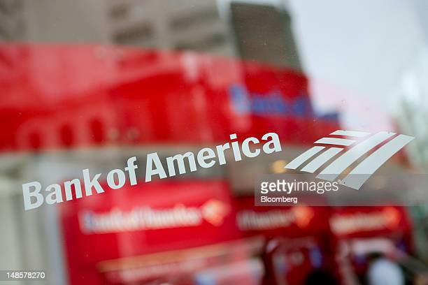 The Bank of America Corp logo is displayed on the window of a branch in New York US on Wednesday July 18 2012 Bank of America Corp the second biggest...