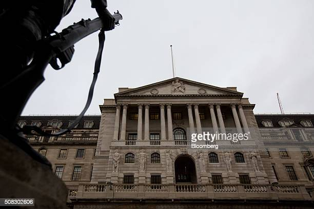The Bank of England facade stands beyond a war memorial statue in the City of London UK on Thursday Feb 4 2016 Sterling has dropped almost 5 percent...
