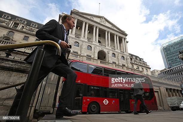 The Bank of England is pictured in central London on August 4 ahead of an expected interest rate reduction The Bank of England is expected to slash...