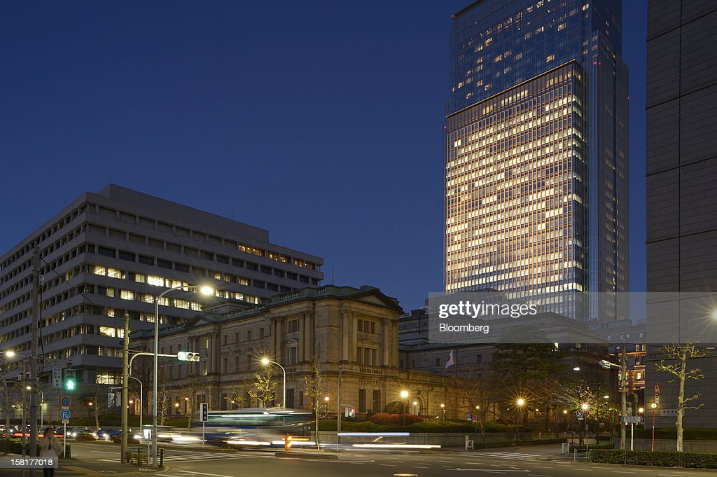 The Bank of Japan headquarters, center, stands in Tokyo, Japan, on Monday, Dec. 10, 2012. Japan's bond market is signaling concern that a government run by Shinzo Abe will ramp up spending to revive growth, adding to a debt burden already twice the size of the nation's economy. Photographer: Akio Kon/Bloomberg via Getty Images