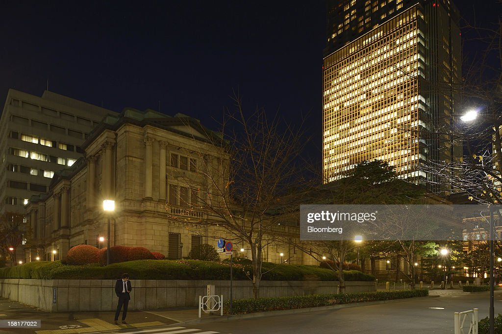 The Bank of Japan headquarters, front, stands in Tokyo, Japan, on Monday, Dec. 10, 2012. Japan's bond market is signaling concern that a government run by Shinzo Abe will ramp up spending to revive growth, adding to a debt burden already twice the size of the nation's economy. Photographer: Akio Kon/Bloomberg via Getty Images