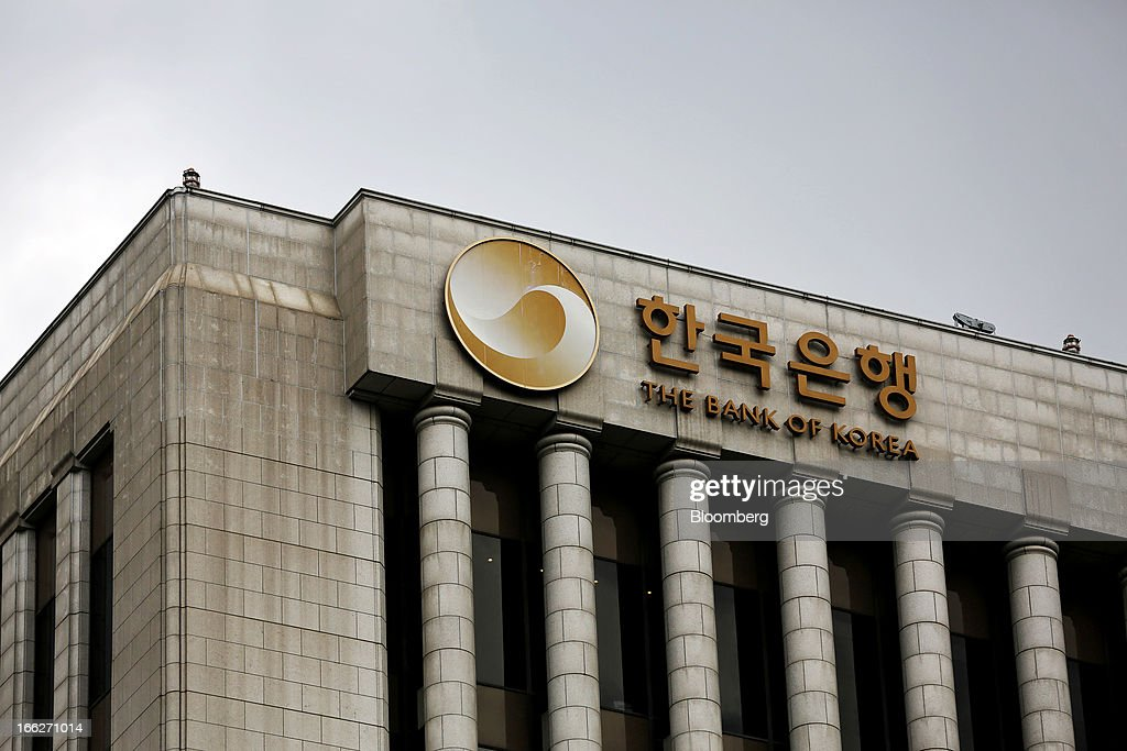The Bank of Korea logo is displayed atop the central bank's headquarters in Seoul, South Korea, on Thursday, April 11, 2013. The Bank of Korea held borrowing costs unchanged for a sixth month, resisting pressure from the government for a reduction even as a sliding yen hurts the nation's exporters and North Korea threatens war. Photographer: SeongJoon Cho/Bloomberg via Getty Images