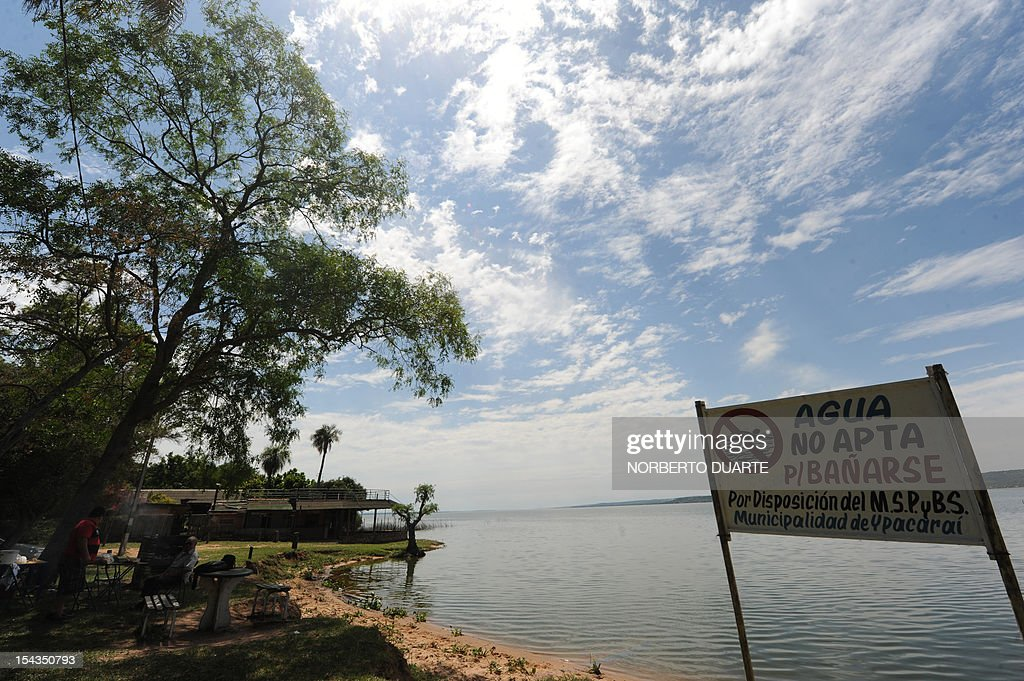 The banks of the Ypacarai Lake, declared not suitable for bathing, in Ypacarai, Paraguay on October 18, 2012. Paraguay's Health Minister Antonio Corbo said that water samples from the lake analized in Sao Paulo, Brazil with the backing of the Pan American Health Organization determined that the bacteria found in the lake's waterweed present a high level of neurologic and liver toxicity.