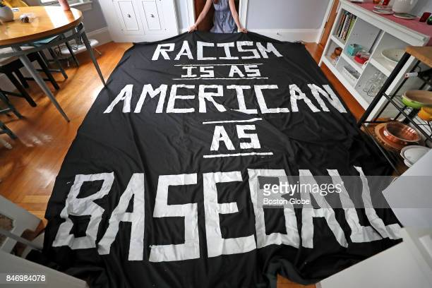 The banner reading 'Racism is as American as Baseball' that was displayed during a Red Sox game at Fenway Park the previous night is shown in the...