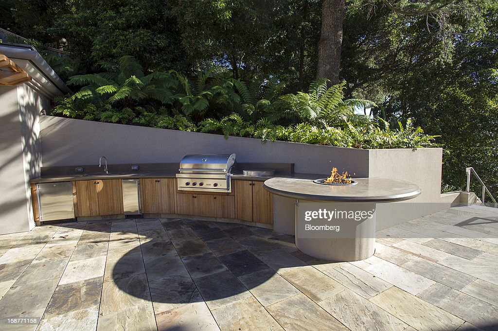 The barbecue area of a 15,000 square-foot custom built home is seen on Belvedere Island in Marin County, California, U.S., on Wednesday, Dec. 19, 2012. The builder couldn't find a buyer for the brand-new waterfront mansion he listed in January for $45 million. He hopes one will turn up at a Dec. 30 auction, where the starting bid will be $25 million. Photographer: David Paul Morris/Bloomberg via Getty Images