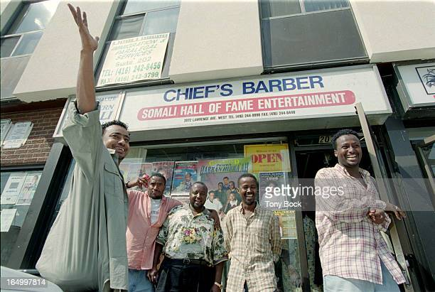 The barbers are Gafaaje Iyo Ali Kaar is wearing baseball hat In the chair are A Sabrie short hair and Shire Ali goatee In the record store Abdull...