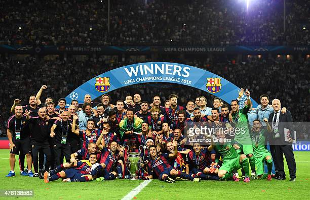The Barcelona team celebrate victory with the trophy after the UEFA Champions League Final between Juventus and FC Barcelona at Olympiastadion on...