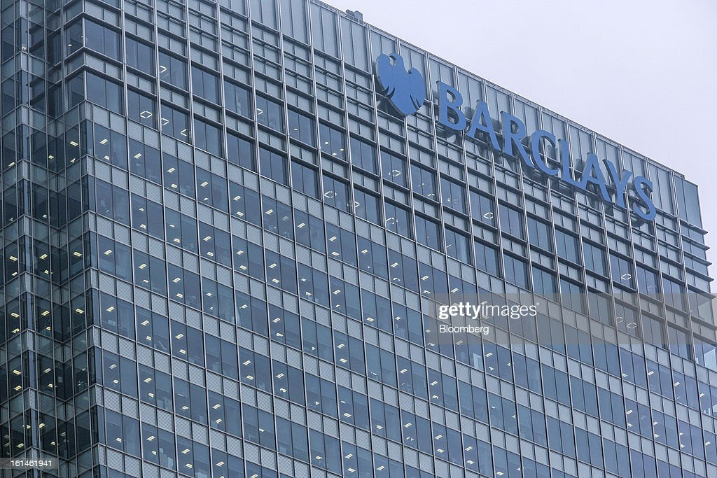 The Barclays Plc logo sits on a glass wall at the top of the company's headquarters in the Canary Wharf business and financial district in London, U.K., on Monday, Feb. 11, 2013. Barclays Plc Chief Executive Officer Antony Jenkins's pledges to shred the legacy of his predecessor and fix the lender's culture are distracting from the difficulty he has in reviving profit at Britain's biggest investment bank. Photographer: Jason Alden/Bloomberg via Getty Images