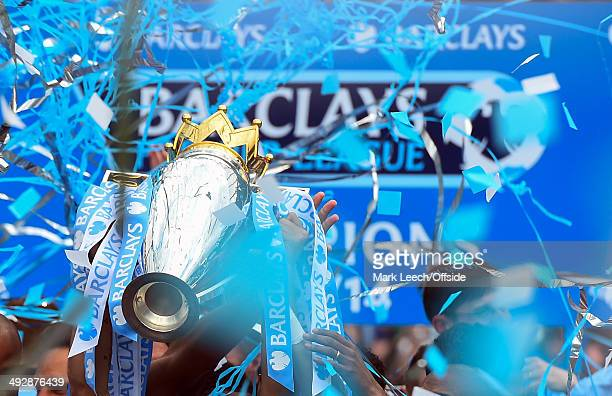 The Barclays Premier League Trophy adorned with sky blue and white ribbons during the Barclays Premier League match between Manchester City and West...