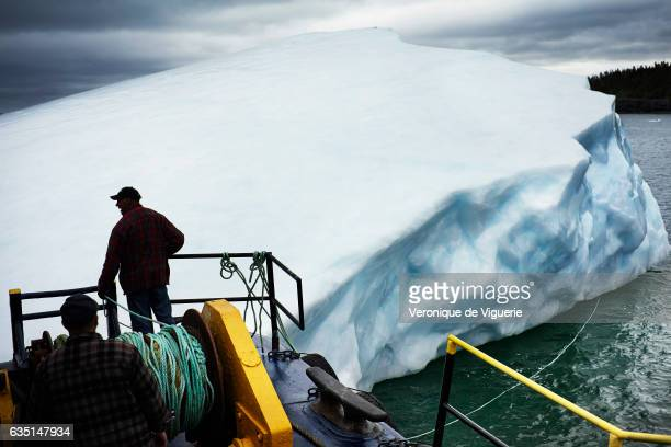 The barge is attached to the new iceberg found by Ed Kean As more icebergs drift south due to climate change a few enterprising seafarers have begun...