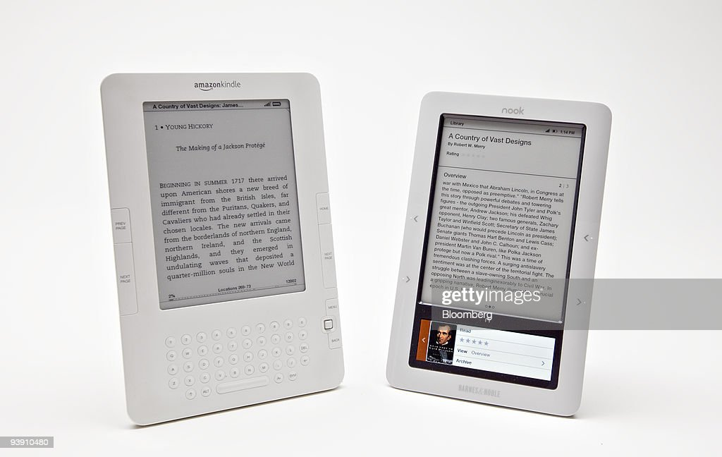 The Barnes Noble Nook electronic book reader right and the Amazoncom Kindle 2 ebook reader are displayed for a photograph in New York US on Friday...