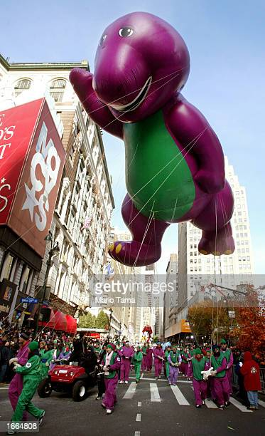The Barney balloon is carried past Macy's department store during the 76th annual Macy's Thanksgiving Day Parade November 28 2002 in New York City...