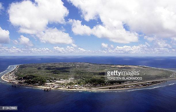 The barren and bankrupt island state of the Republic of Nauru awaits the arrival of 521 mainly Afghan refugees 11 September 2001 which have been...