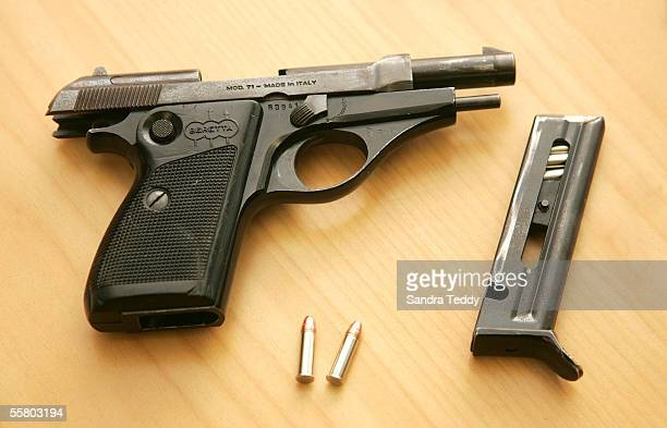 The Barretta semiautomatic pistol that was found loaded next to one of the sleeping gang members who has been arrested in conjunction with Operation...