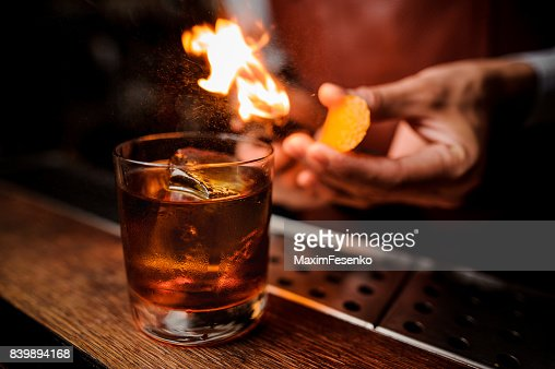 The bartender makes flame above cocktail close up : Stock Photo