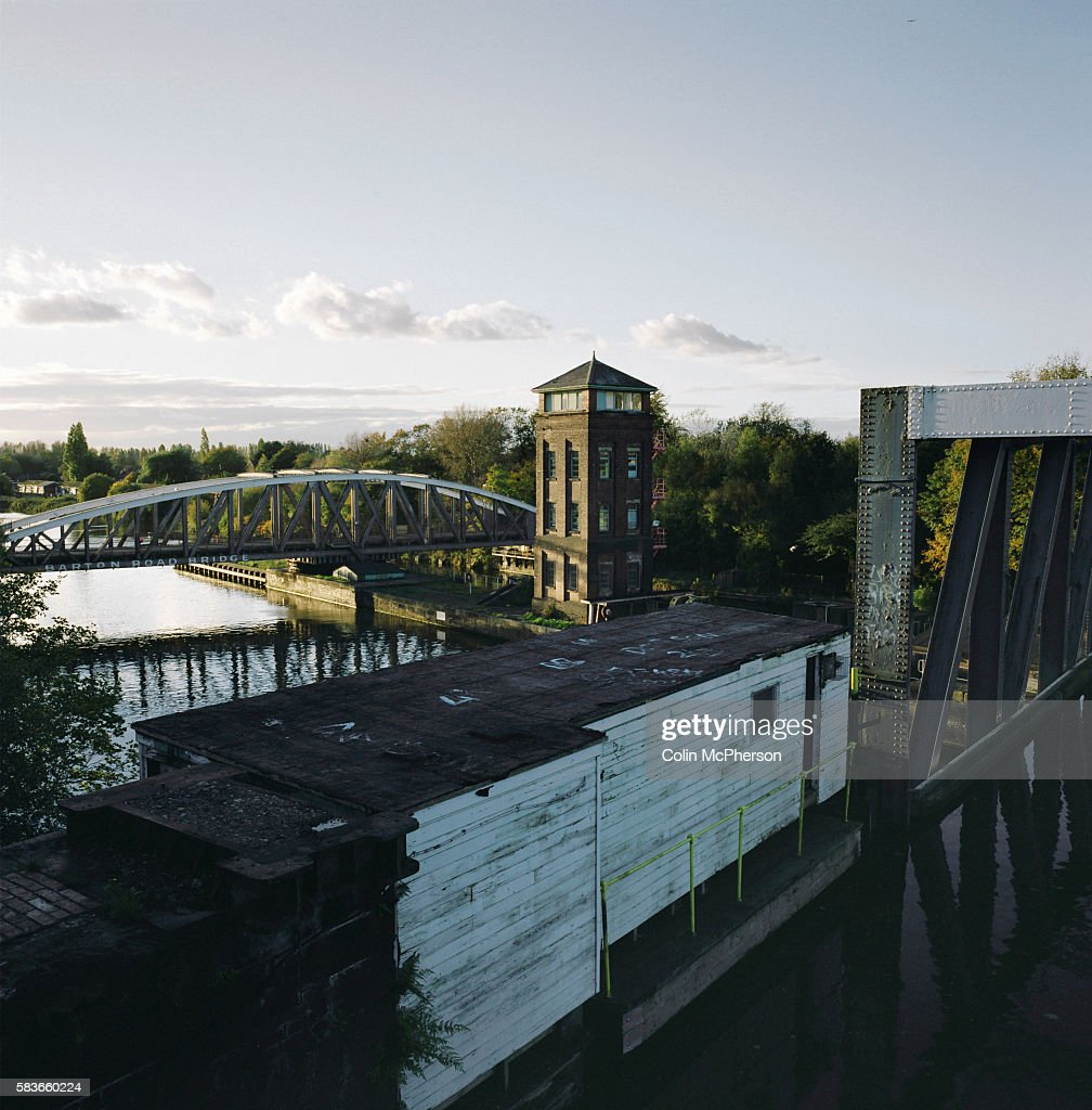 The Barton swing bridge and aqueduct in BartonUponIrwell which crosses the Manchester Ship Canal as it carries the river Mersey and the Bridgewater...