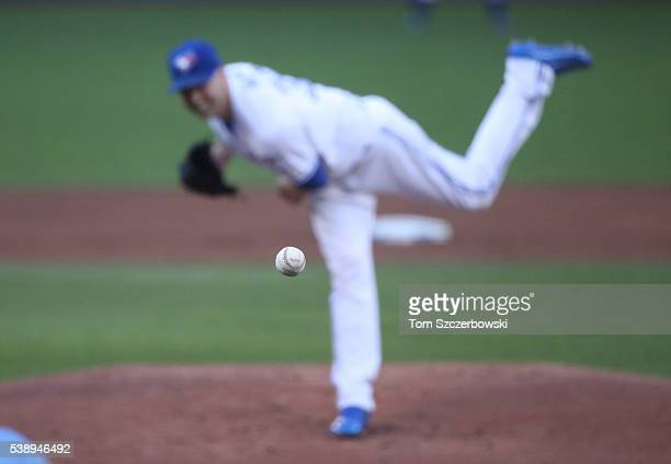 The baseball is captured in flight toward the batter as it is delivered by JA Happ of the Toronto Blue Jays who delivers a pitch in the first inning...