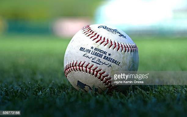 The baseball lies on the grass as the Los Angeles Angels face the Cleveland Indians at Angel Stadium of Anaheim on June 10 2016 in Anaheim California
