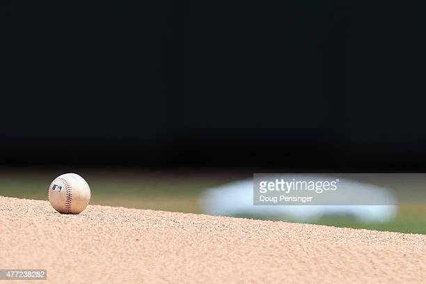 The baseball sits on the mound as the Colorado Rockies prepare to take the field to face the St Louis Cardinals at Coors Field on June 10 2015 in...