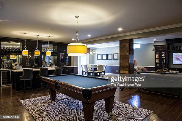 The Basement Rec Room with Billards at the Bridle Ridge Farmhouse Model at Villas at Dominion Country Club on July 29 2015 in Haymarket Virginia