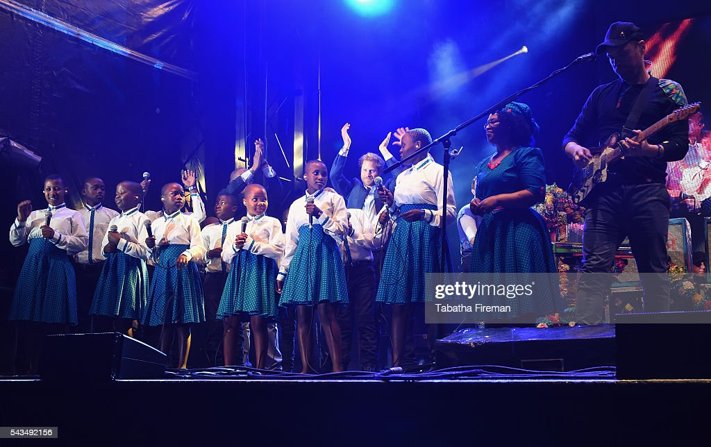 The Basotho Youth Choir and Coldplay perform on stage at the finale of the Sentebale Concert at Kensington Palace on June 28, 2016 in London, England. Sentebale was founded by Prince Harry and Prince Seeiso of Lesotho over ten years ago. It helps the vulnerable and HIV positive children of Lesotho and Botswana.
