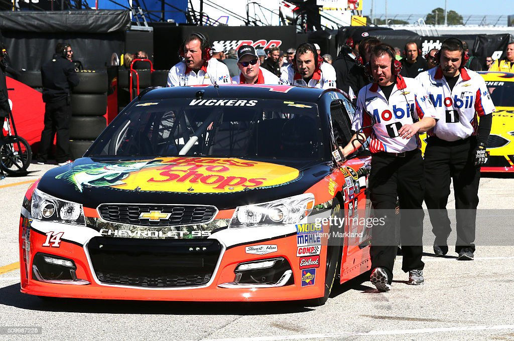 The #14 Bass Pro Shops/Mobil 1 Chevrolet, driven by Brian Vickers (not pictured), is pushed through the garage area during practice for the NASCAR Sprint Cup Series Daytona 500 at Daytona International Speedway on February 13, 2016 in Daytona Beach, Florida.