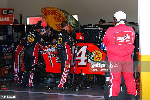 The Bass Pro Shops/Mobil 1 Chevrolet driven by Tony Stewart is repaired in the garage after being involved in an ontrack incident during the NASCAR...