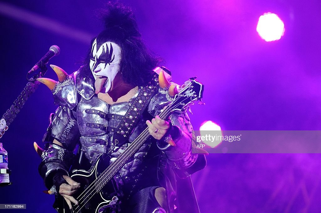 The bassist of US rock band Kiss Gene Simmons performs on stage during the Hellfest Heavy Music Festival on June 22 2013 in Clisson western France...