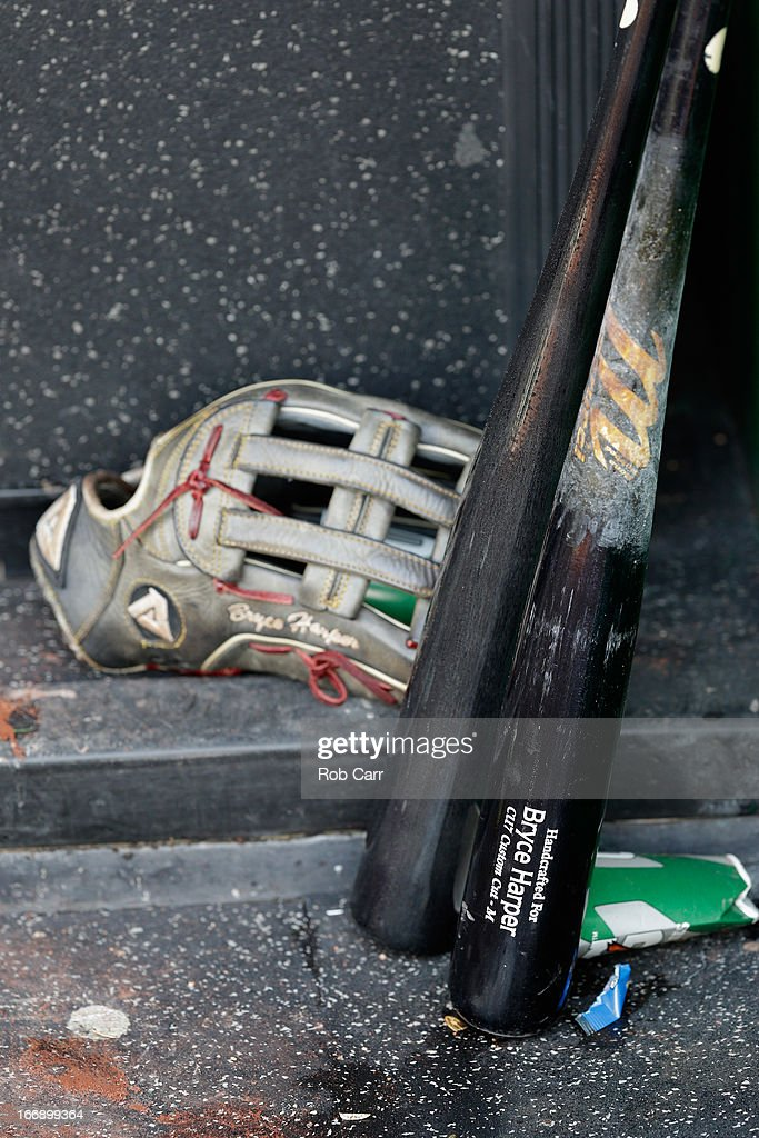 The bat and glove of <a gi-track='captionPersonalityLinkClicked' href=/galleries/search?phrase=Bryce+Harper&family=editorial&specificpeople=5926486 ng-click='$event.stopPropagation()'>Bryce Harper</a> #34 of the Washington Nationals sits in the dugout following the Nationals opening day win over the Miami Marlins at Nationals Park on April 1, 2013 in Washington, DC.