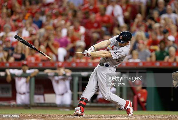 The bat of Brandon Moss of the St Louis Cardinals breaks as he hits the ball in the 8th inning against the Cincinnati Reds at Great American Ball...