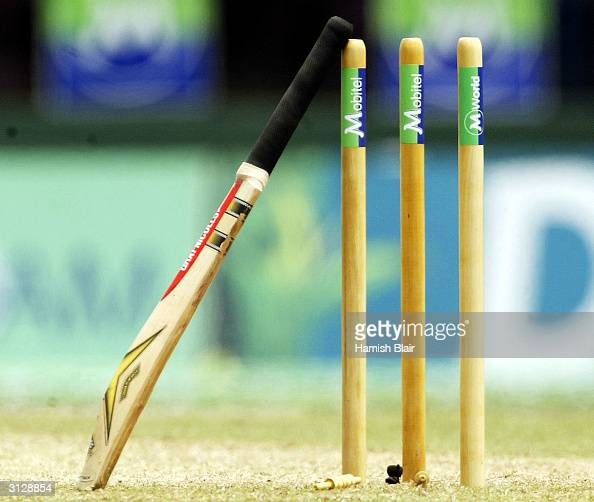 The bat of Darren Lehmann of Australia rests against the stumps during the drinks break in the same way his late friend and former Australian batsman...