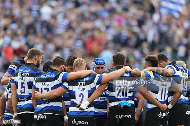 The Bath team receive a team talk after the end of the first half during the Aviva Premiership match between Bath Rugby and Worcester Warriors at...