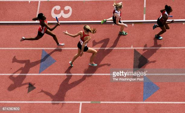 The baton exchange during on of the many 4x400m relays heats during the 123rd running of the Penn Relays in Philadelphia PA on April 27 2017