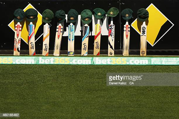 The bats and caps of the Australian cricket team are left by the field in a tribute to the late Phillip Hughes during day one of the First Test match...