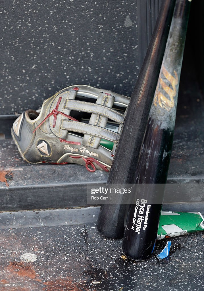 The bats and glove of Bryce Harper #34 of the Washington Nationals sit in the dugout following the Nationals 2-0 win over the Miami Marlins during opening day at Nationals Park on April 1, 2013 in Washington, DC.